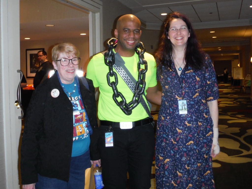 Authors Kathryn Sullivan, T. Aaron Cisco, and S.N.Arly in the hallway between panels.